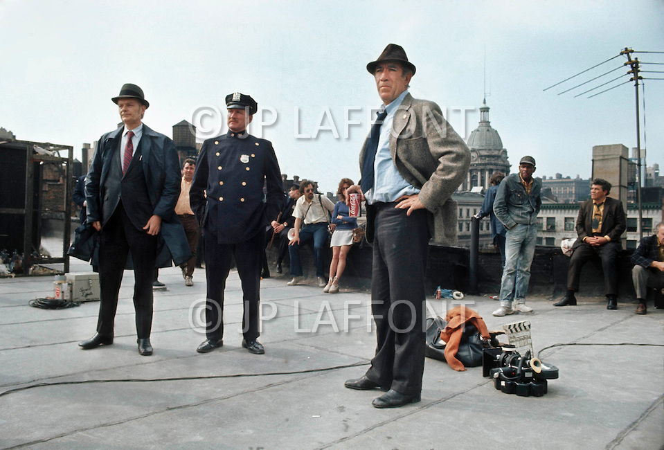 New York, NY, July 1972. Anthony Quinn as the Capt. Mattelli on set on Harlem rooftops. - Across 110th Street is a 1972 American crime drama film directed by Barry Shear. Commonly associated with the blaxploitation genre at the time, it has received considerable critical praise for surpassing the limitations of that genre.